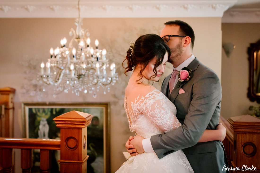 The stunning chandelier makes a perfect backdrop for romantic couple photos at this Gardens on Forest wedding