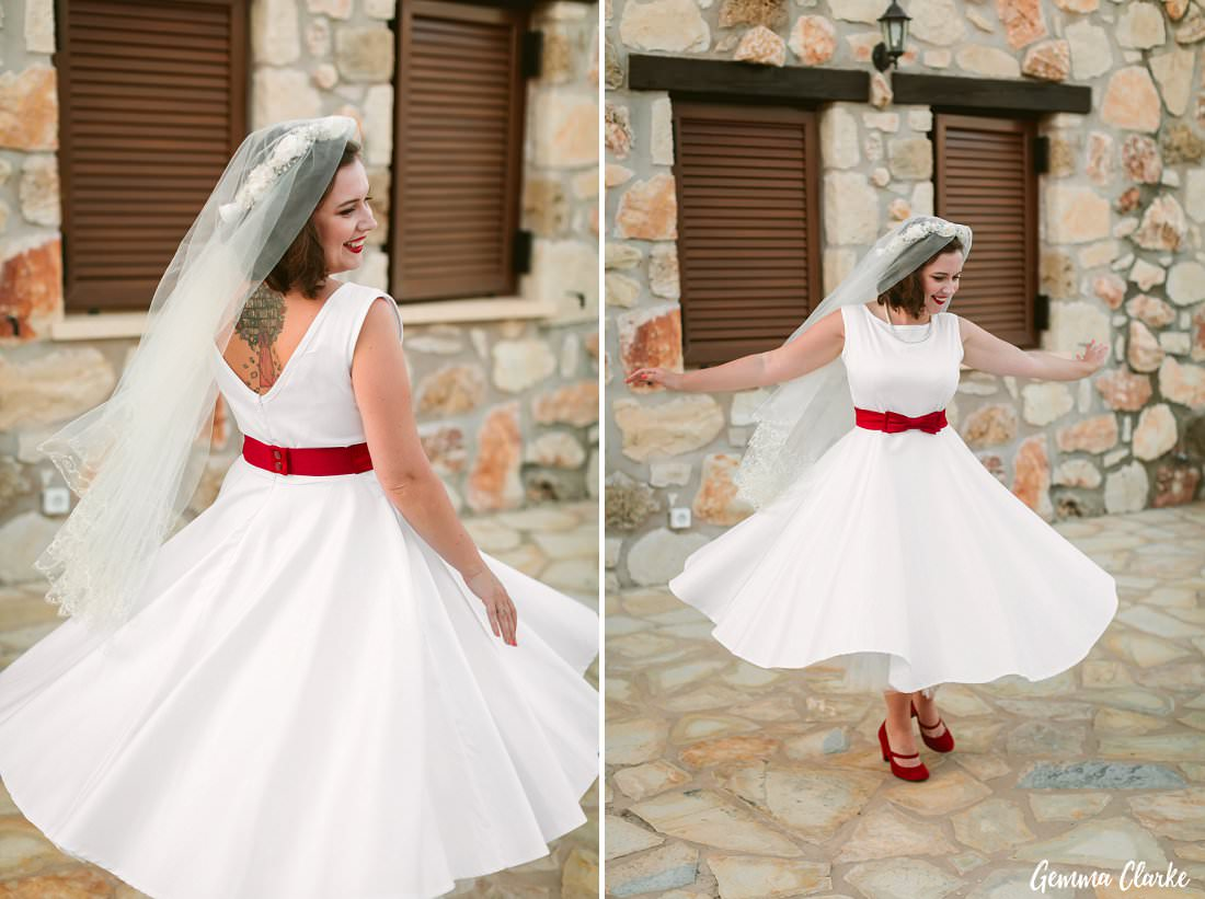 The bride wearing her mama's veil and rocking her red belt and shoes at her Greek Villa Wedding