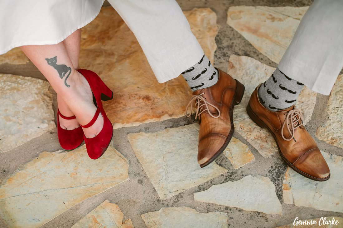 Very cool wedding attire and shoes and tattoos and socks at this Greek Villa Wedding!