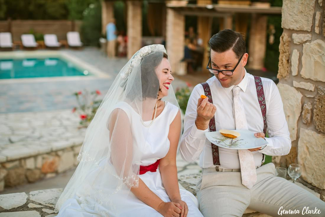 Laughing over snacks at their Greek Villa Wedding
