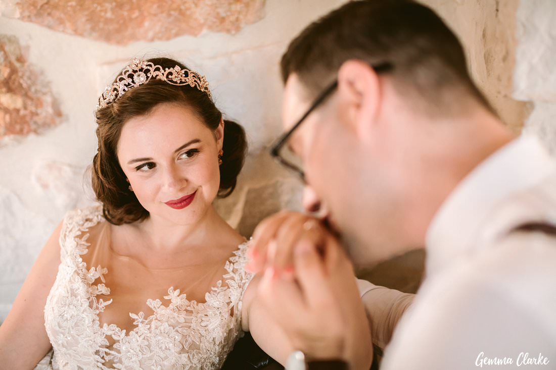 It's all about romance with these two as Justen's gently kisses Rebecca's hand at their Greek Villa Wedding.