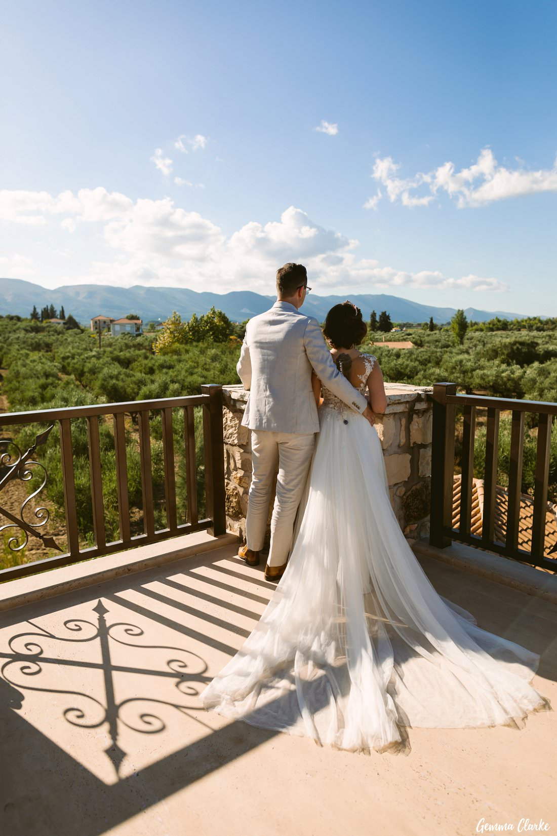 Stunning view over the olive grove with bride and groom at their Greek Villa Wedding