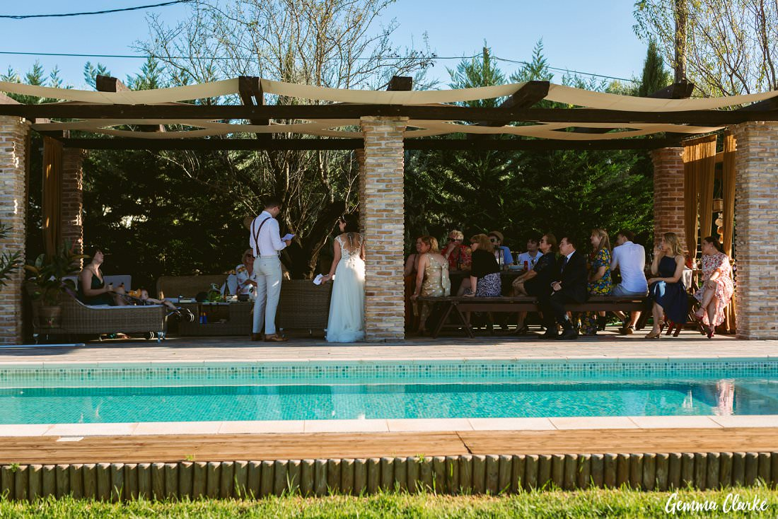 Speeches time by the pool at this Greek Villa Wedding