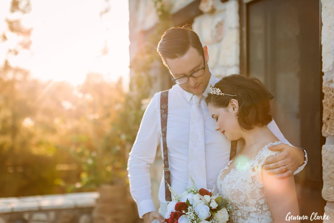 The beautiful soft light lights up this sweet moment between the bride and groom at this Greek Villa Wedding