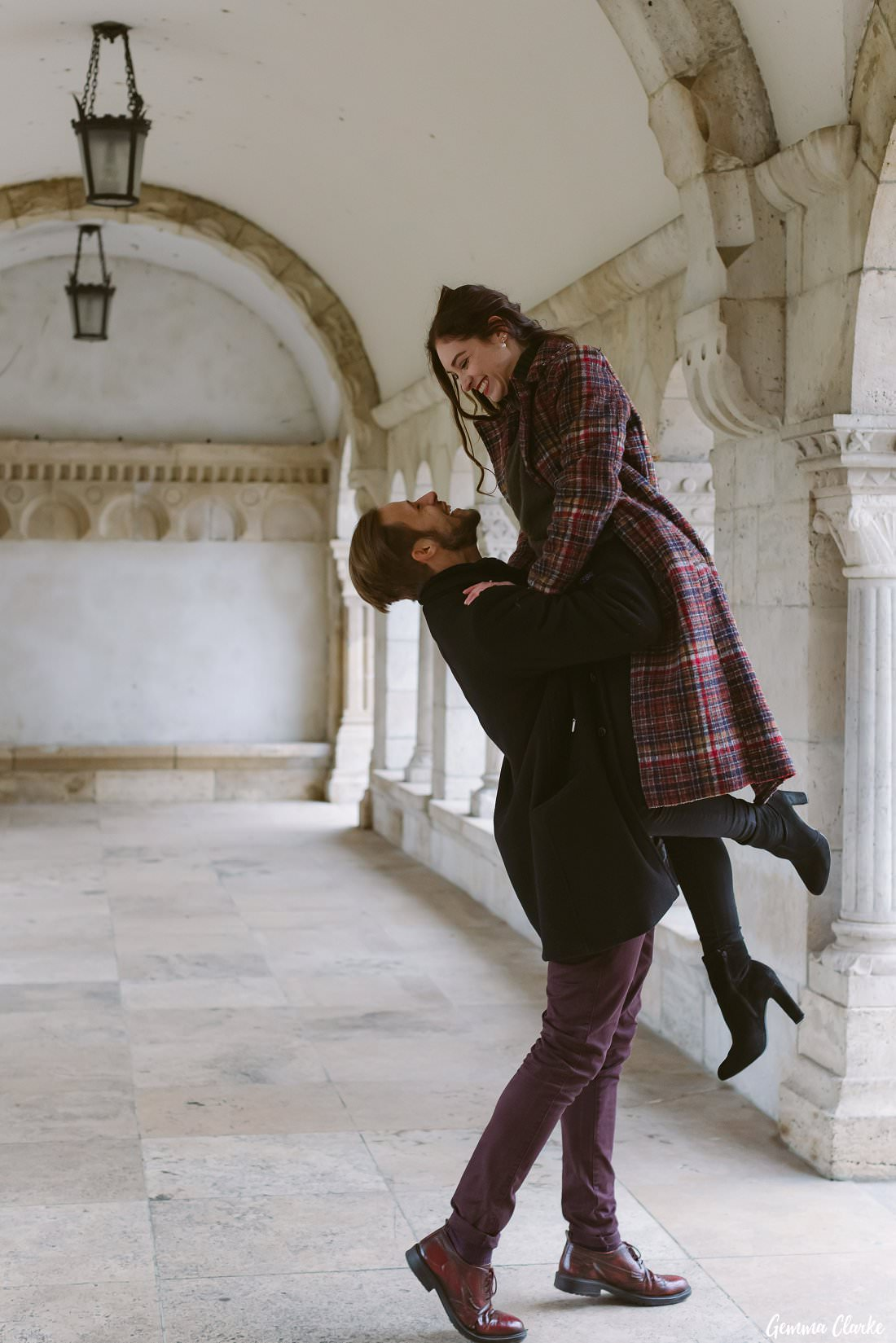 Dancing under the arched walkway of Fisherman's Bastion in Budapest. this couple are so happy!