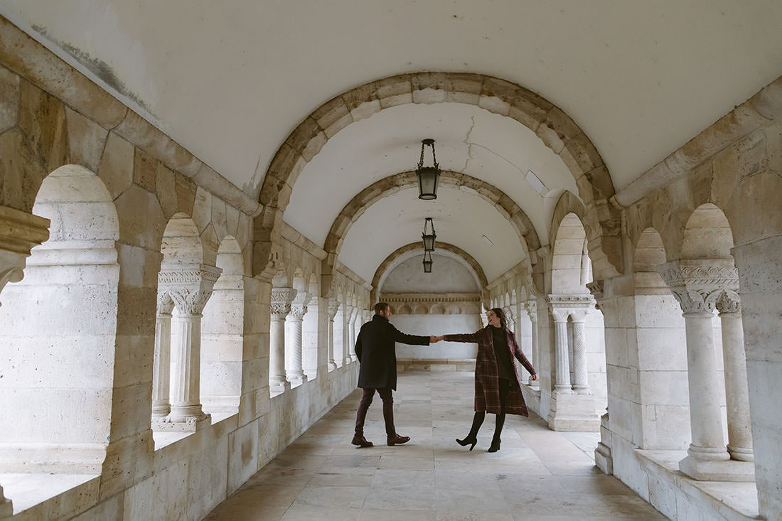 Two dancers enjoy the arched space at Fisherman's Bastion