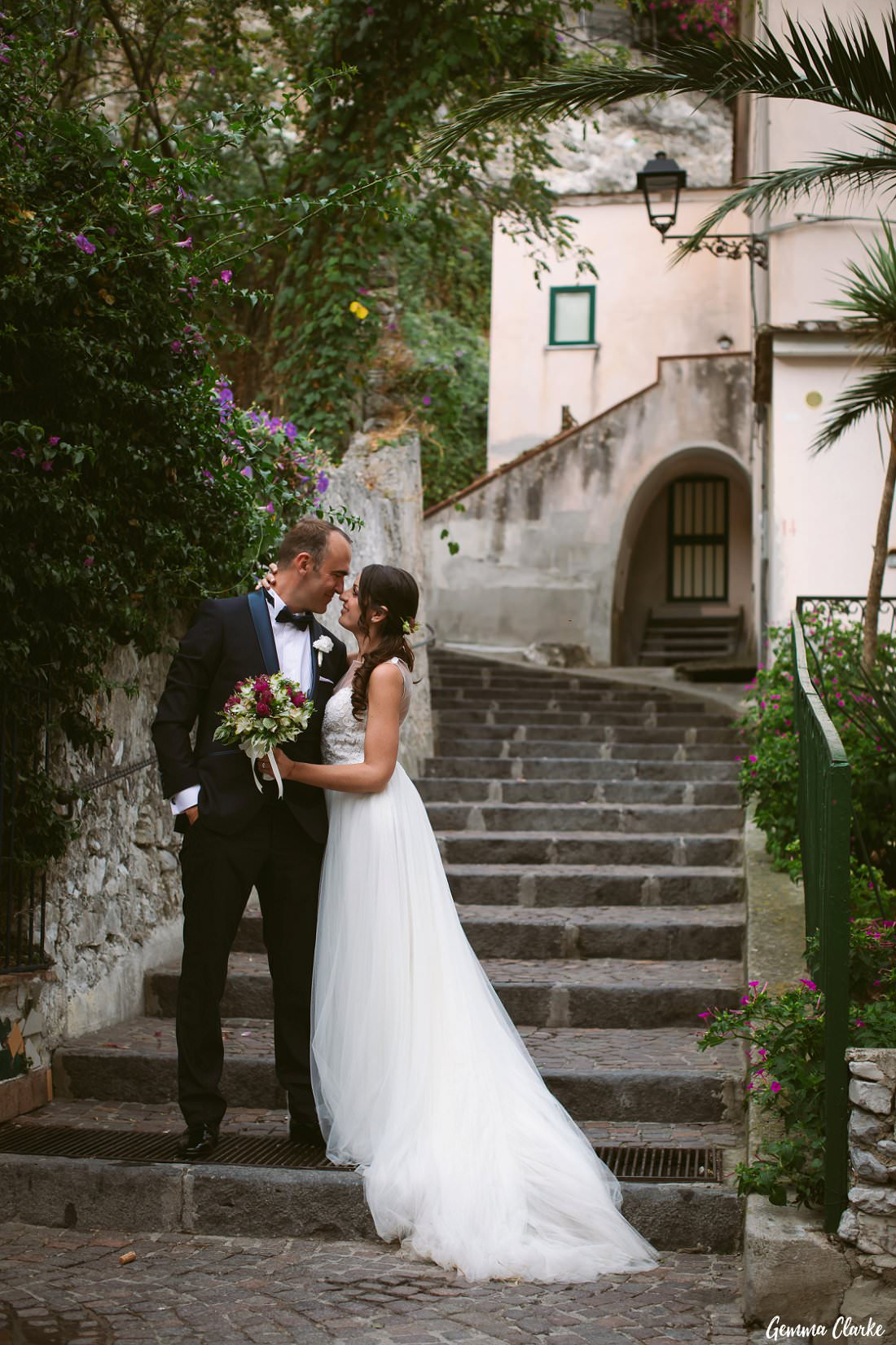 A romantic pose by the stone stairs in the village of Erchie on the Amalfi Coast at this Italian Destination Wedding