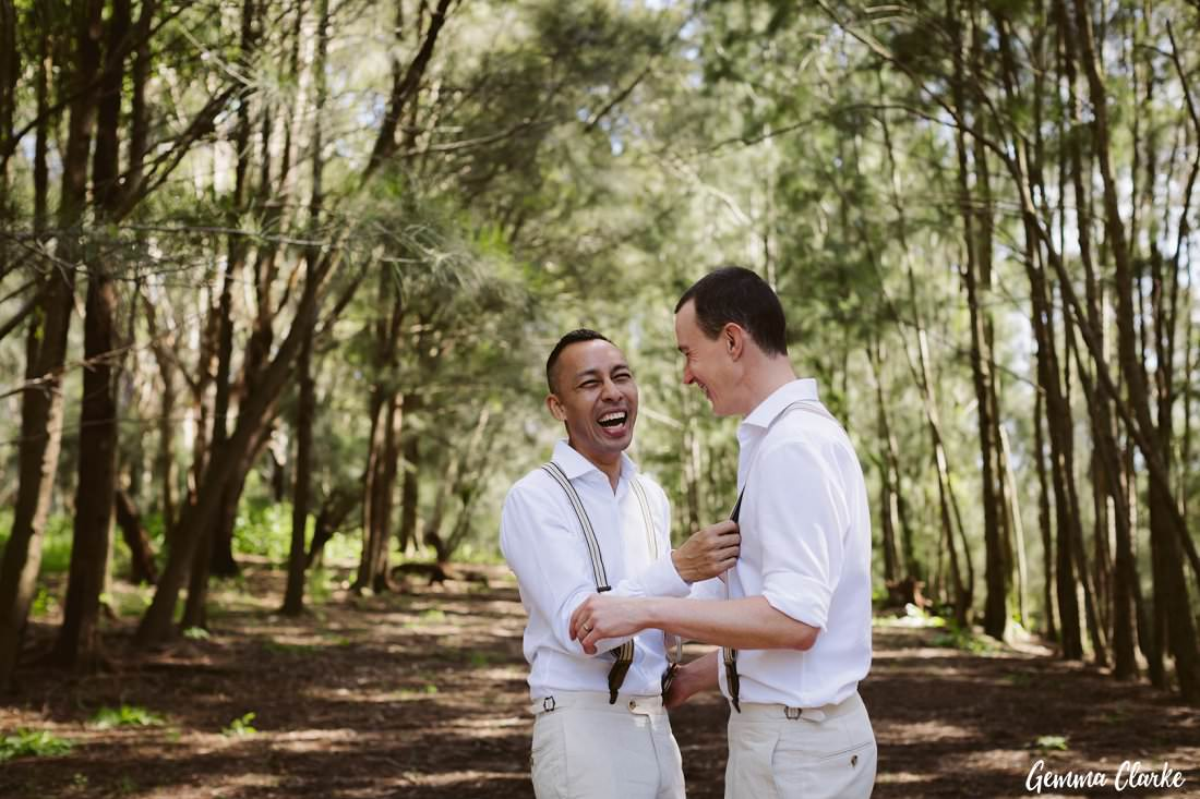 Two grooms being cheeky in the forest at their Sydney Park Wedding