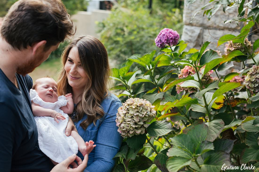 In their front yard and cuddling on the front step with their little Willow - At Home Newborn Photos in Sydney