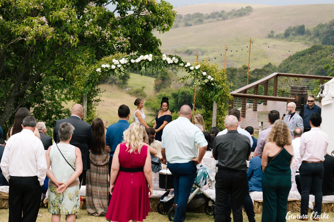 Guests looking on during this garden ceremony at Bush Bank for this Kiama Wedding