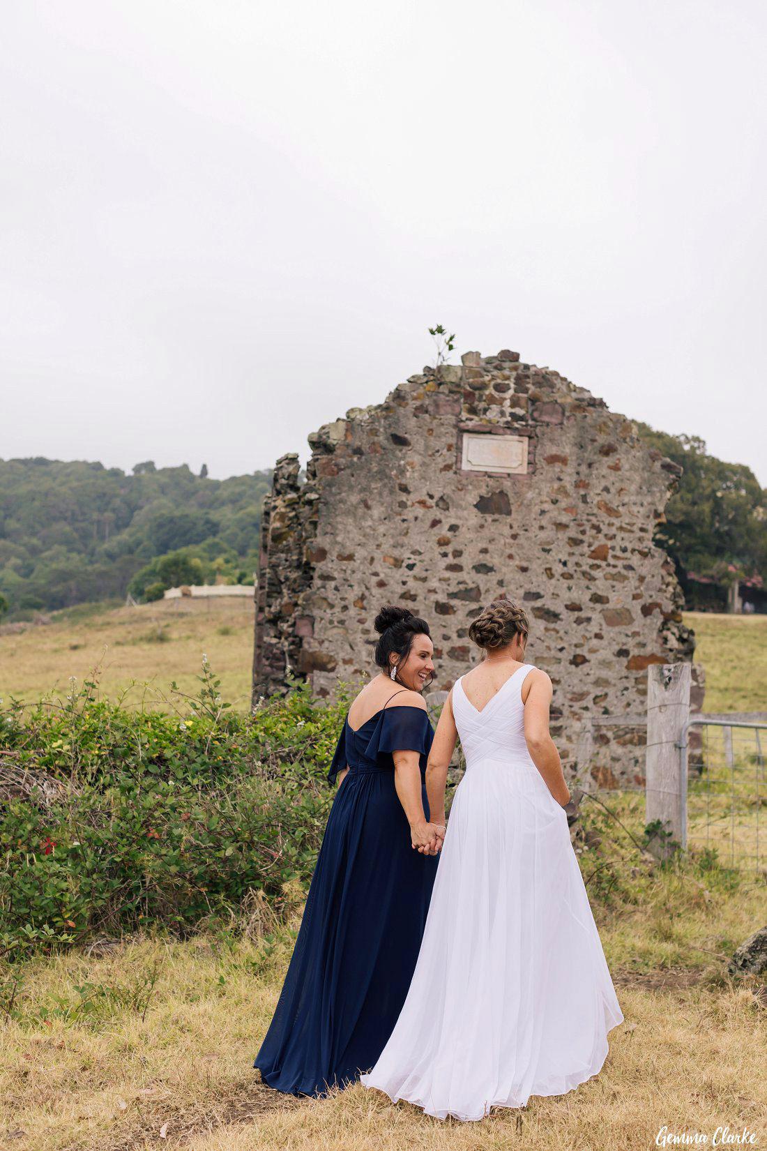 More stone building ruins as the brides walk through the paddock at their Bush Bank Kiama Wedding