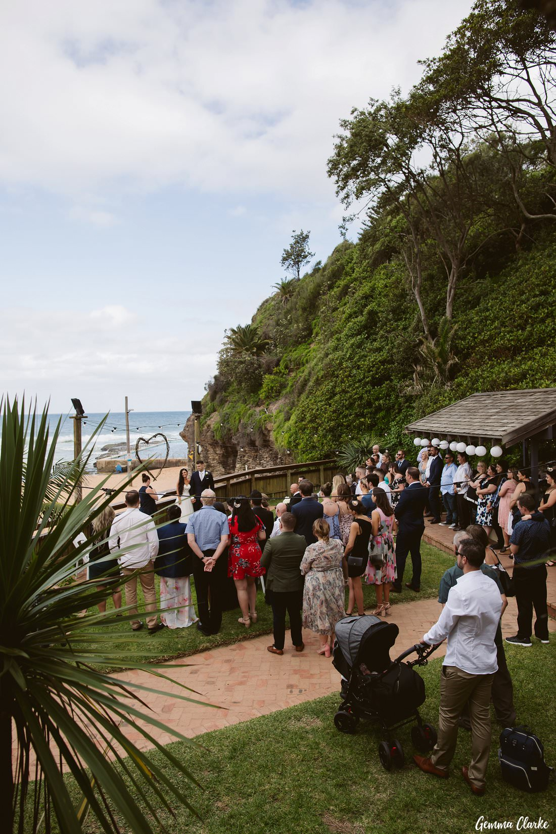 A view from the balcony of the wedding ceremony overlooking the grassed courtyard at this Bilgola Beach Wedding