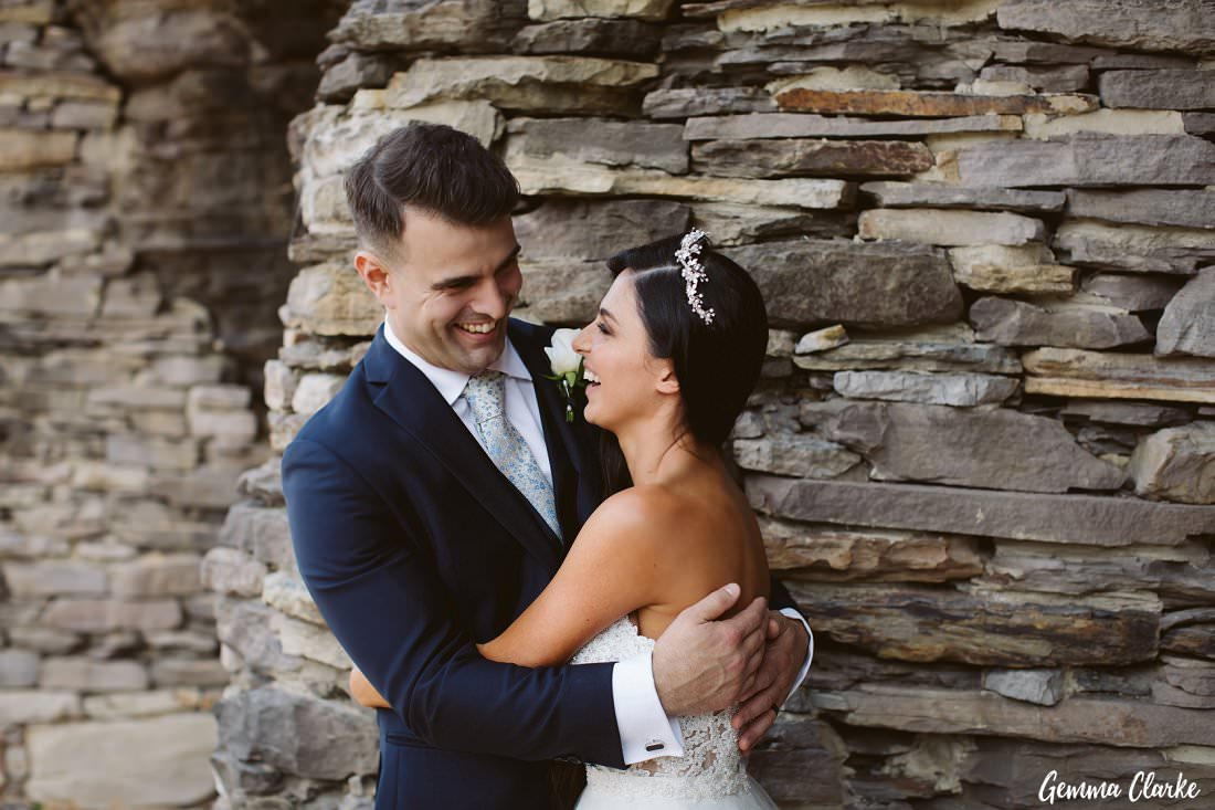 So much happiness between the very happy bride and groom as they stand in front of the stunning rocks at their Bilgola Beach Wedding