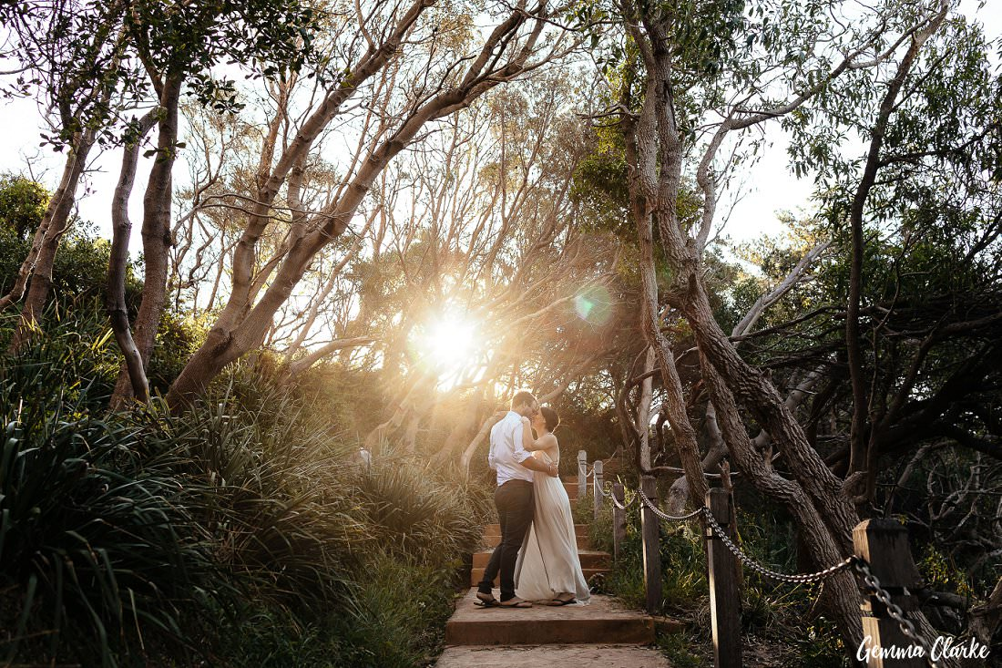 Dancing among the trees at Sandon Point at their Bulli elopement as the sun shines on them