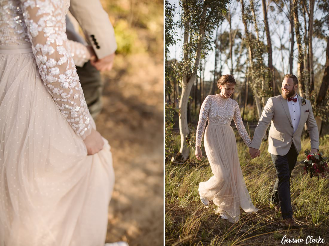 Walking among the bush fire regrowth at their Buxton wedding photo session hand in hand.