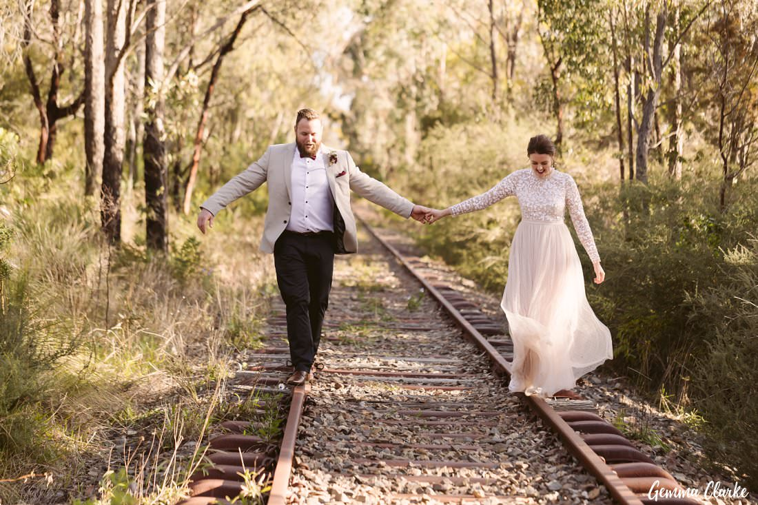 The balancing trick on these old unused train tracks at their Buxton Wedding - hand in hand!