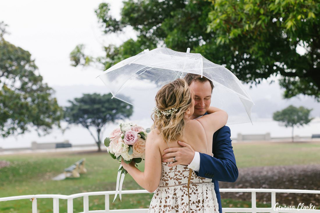 Cuddles under the umbrella for this newly married couple at Balmoral - Rain on your wedding day?