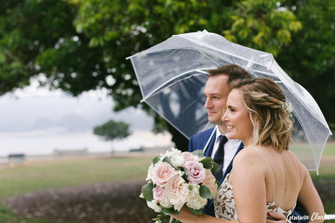 Relaxed captures of a couple newly married - rain on your wedding day?
