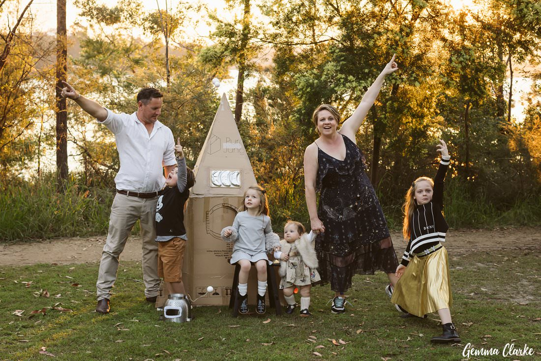 The family look to the skies to celebrate their fun space themed photoshoot