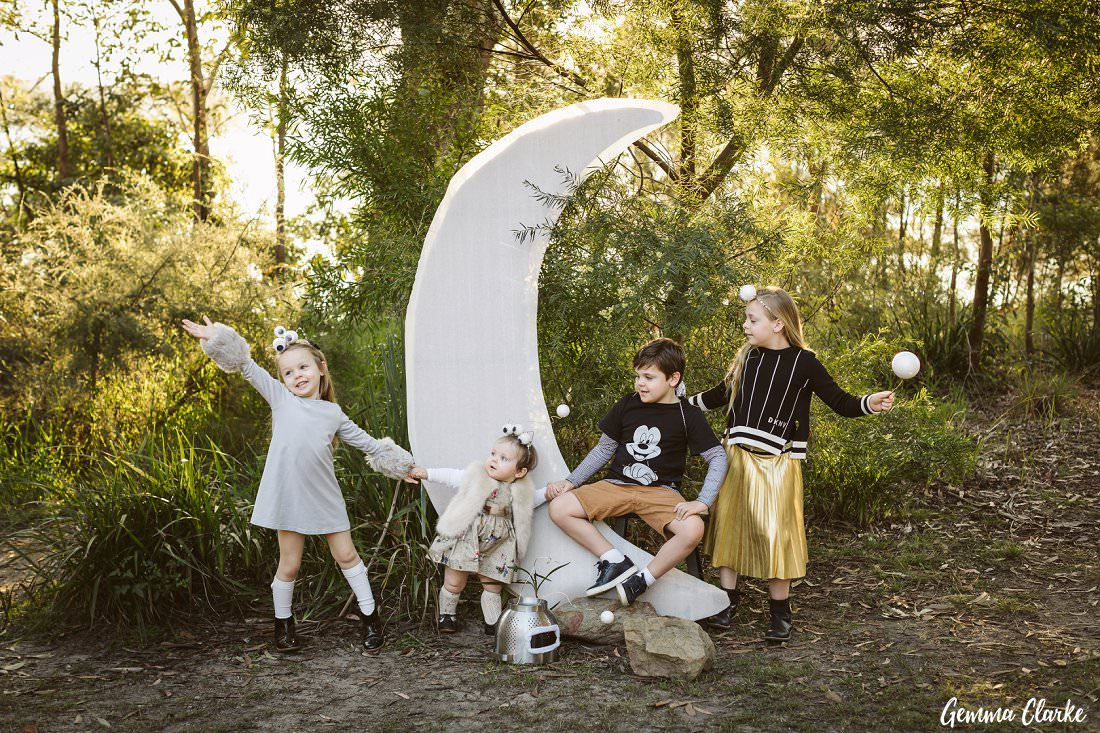 All the siblings love playing together as aliens and a spaceman in front of the moon at this space themed photoshoot