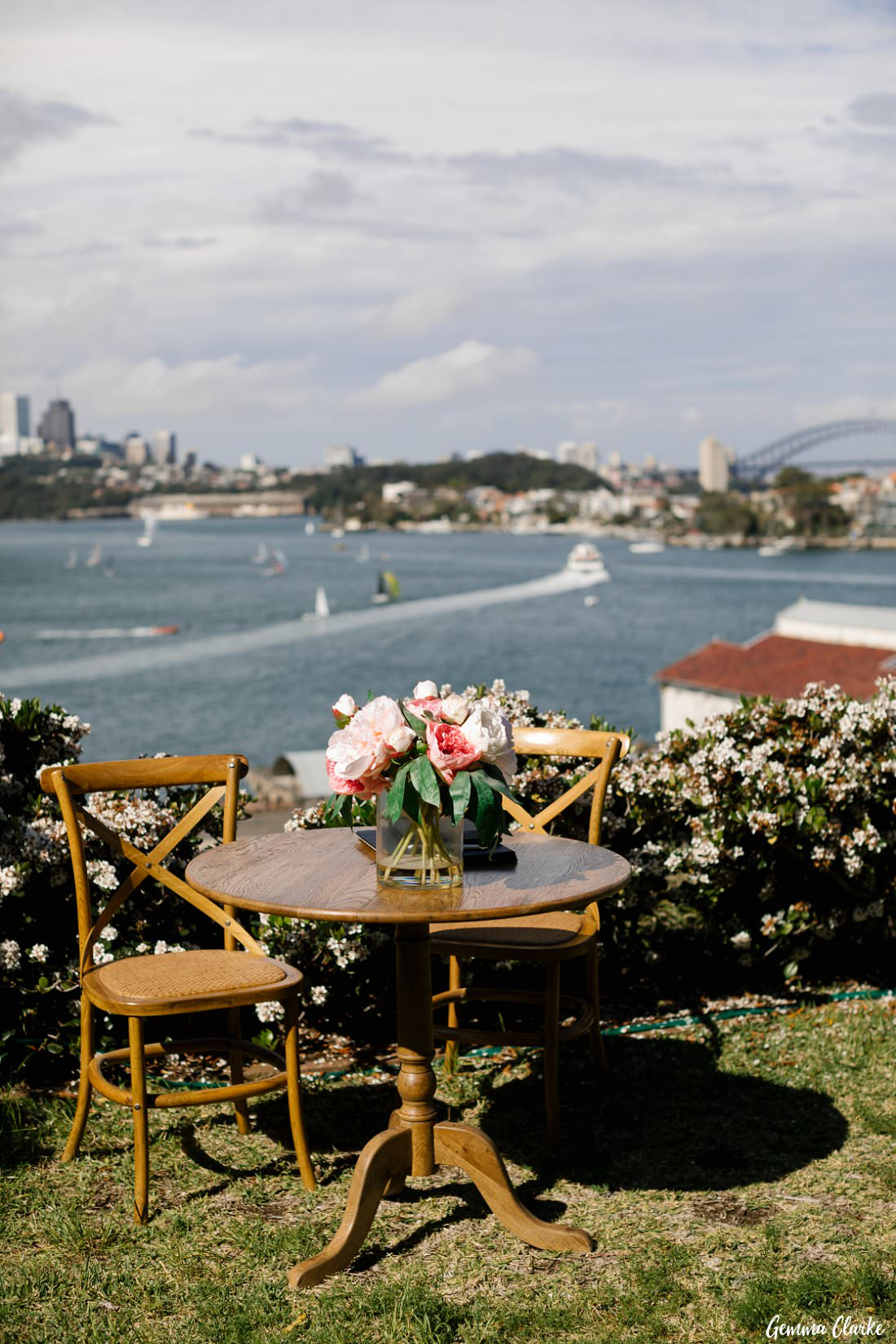 The signing table with the stunning backdrop of Sydney Harbour for the wedding ceremony for this Cockatoo Island Elopement
