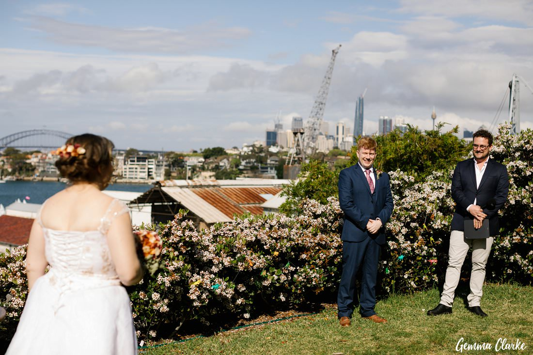 Sunny day in front of the apartments overlooking Sydney Harbour for this Cockatoo Island Elopement
