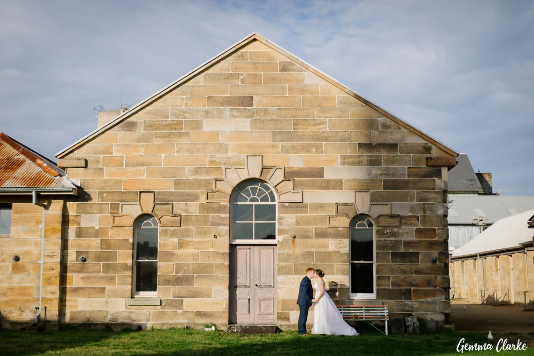 Beautiful sandstone building backdrop for their couple portraits at their Cockatoo Island Elopement