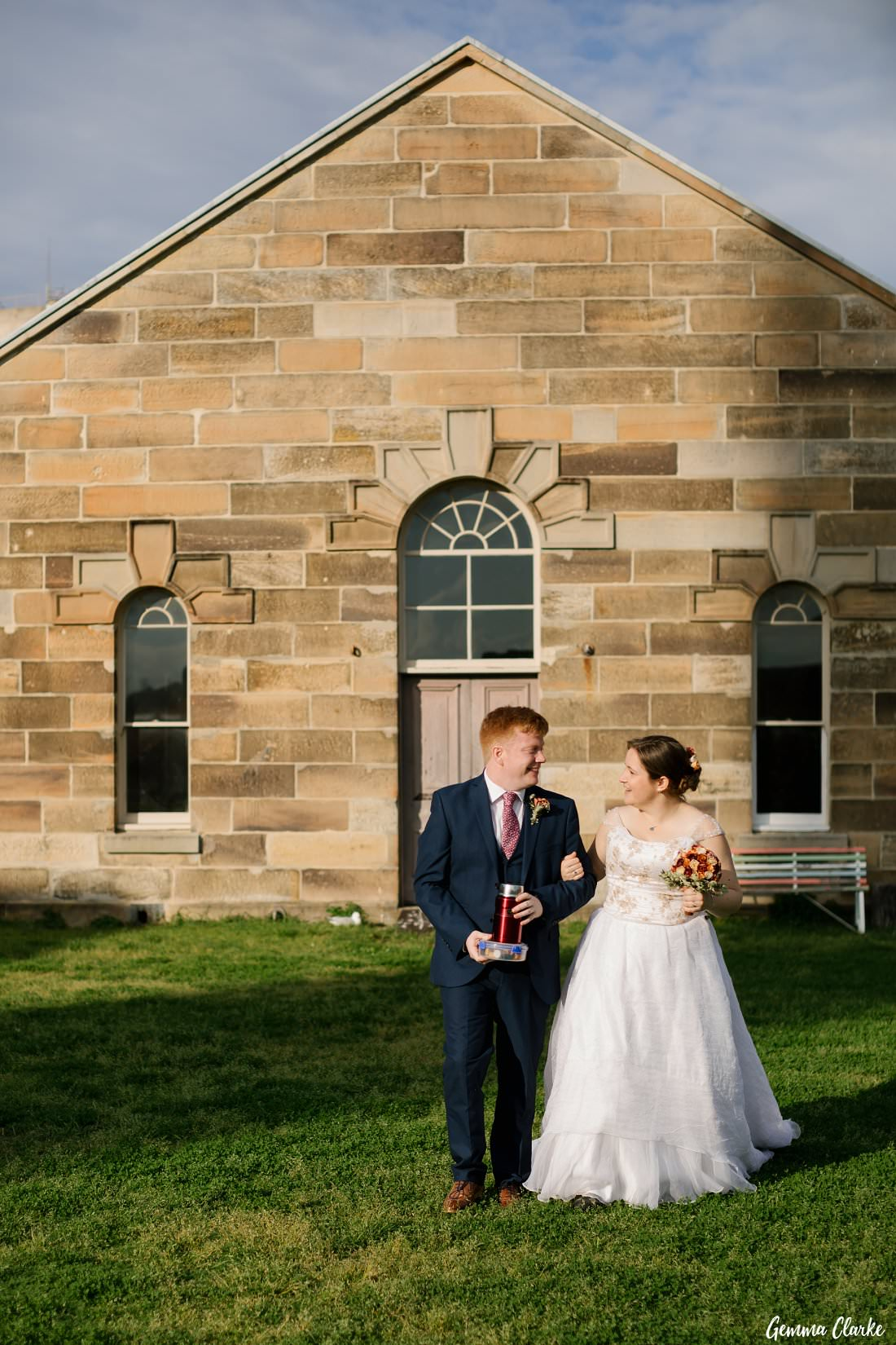 Sandstone backdrop as they walk to their favourite spot for tea and bikkies at their Cockatoo Island Elopement